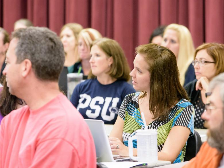 Students listening during a graduate Summer Institute program.