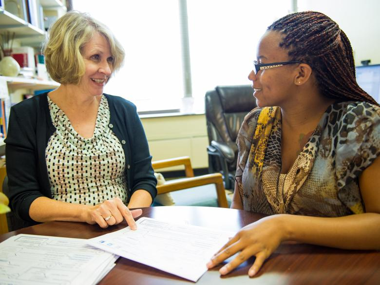 A student meeting with staff in the Advising and Career Development Office.