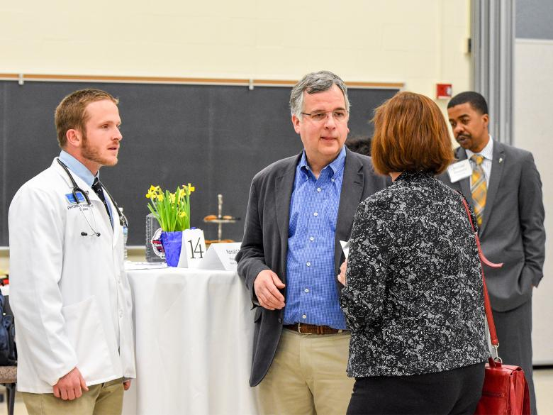 Alumni and staff chat during a Career Networking event.