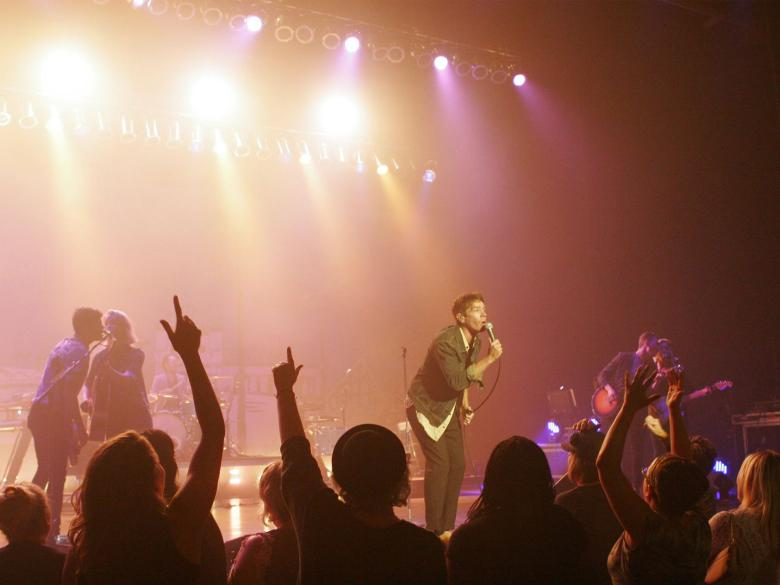 Audience and performers during a rock concert at The Pullo Center.