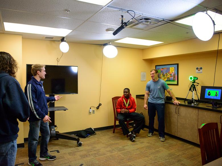 Students working in the One-Button Studio recording video