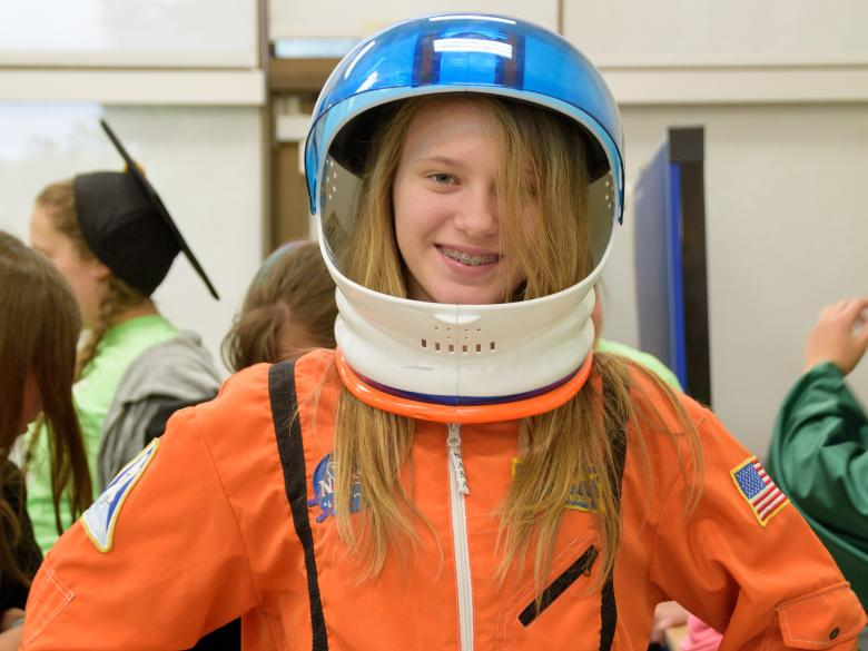 A student wearing an astronaut outfit during the Pathways program.