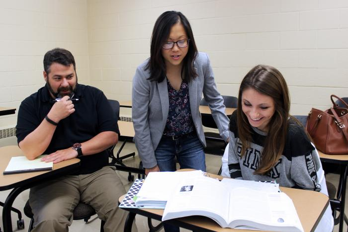 Nicole Muscanell and students in a classroom.