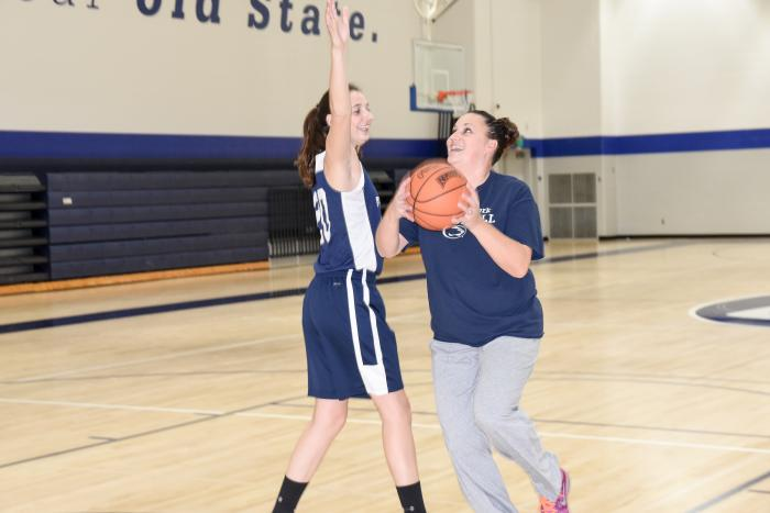 Karra Thomason defends against her mother in a game of one-on-one.