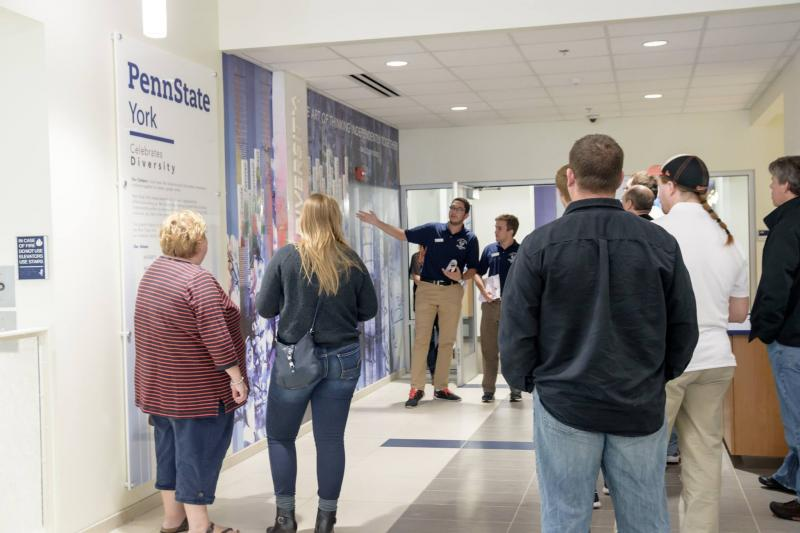 Lion Ambassador Mohamed El Sonbaty gives a tour outside of the Student Affairs office