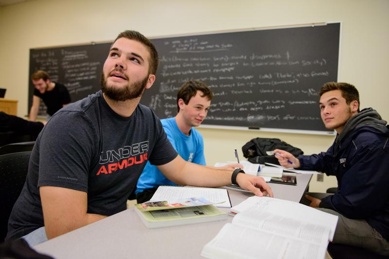 Students working in a group during a political science class with Jon Price, Instructor in History and Political Science.