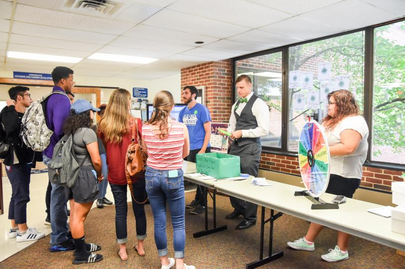 Students and staff gather at a Stand for State promotional event.