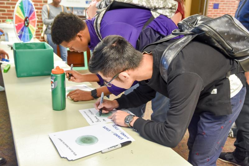 Students writing during a Stand for State event.
