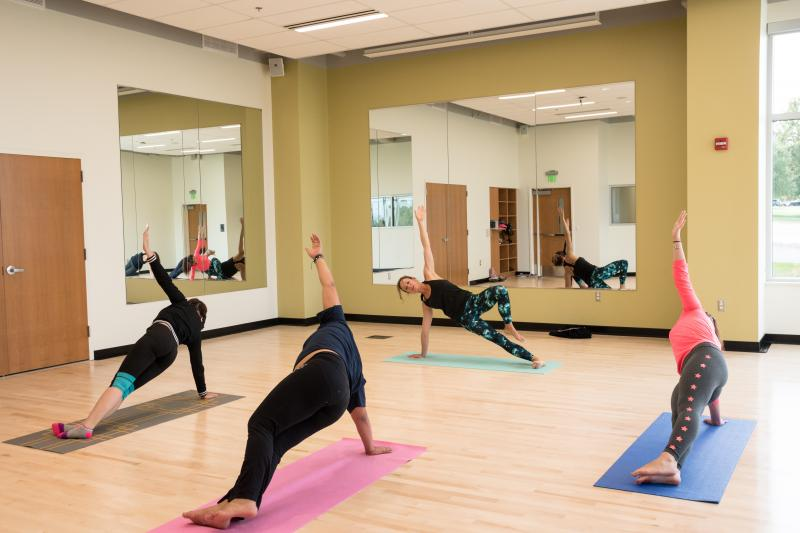 Students taking a yoga class.