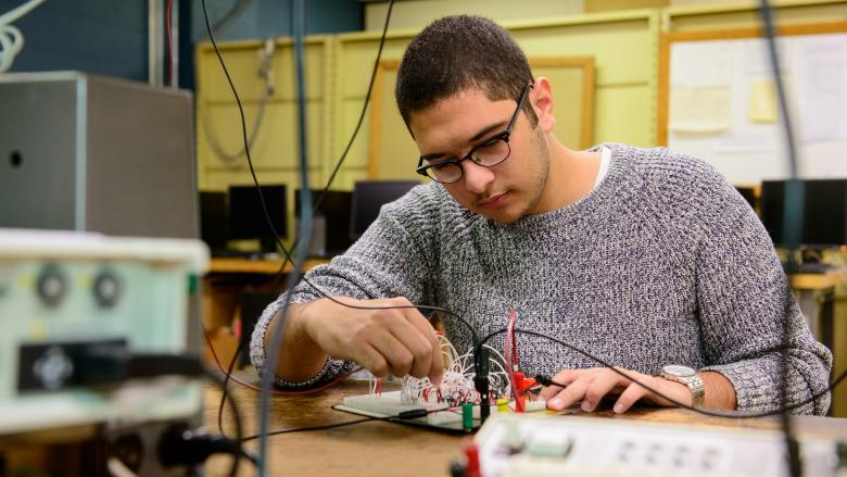 Engineering Student Mohamed El Sonbaty working with electronics in the lab
