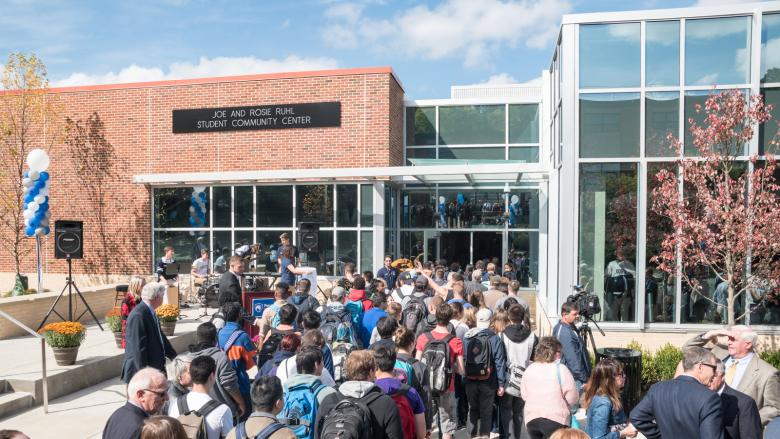 Attendees enter the student center from outside.