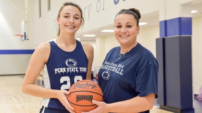 Karra and Amanda Thomason holding a basketball.