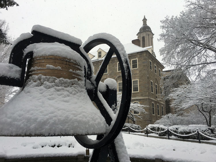 Snow falls on Old Main bell